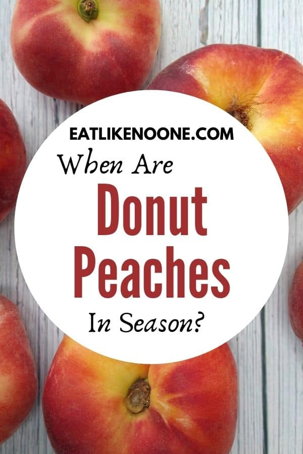 """Donut peaches sitting on a white wood looking background with the words """"When are Donut Peaches in Season"""" over top in a white circle."""