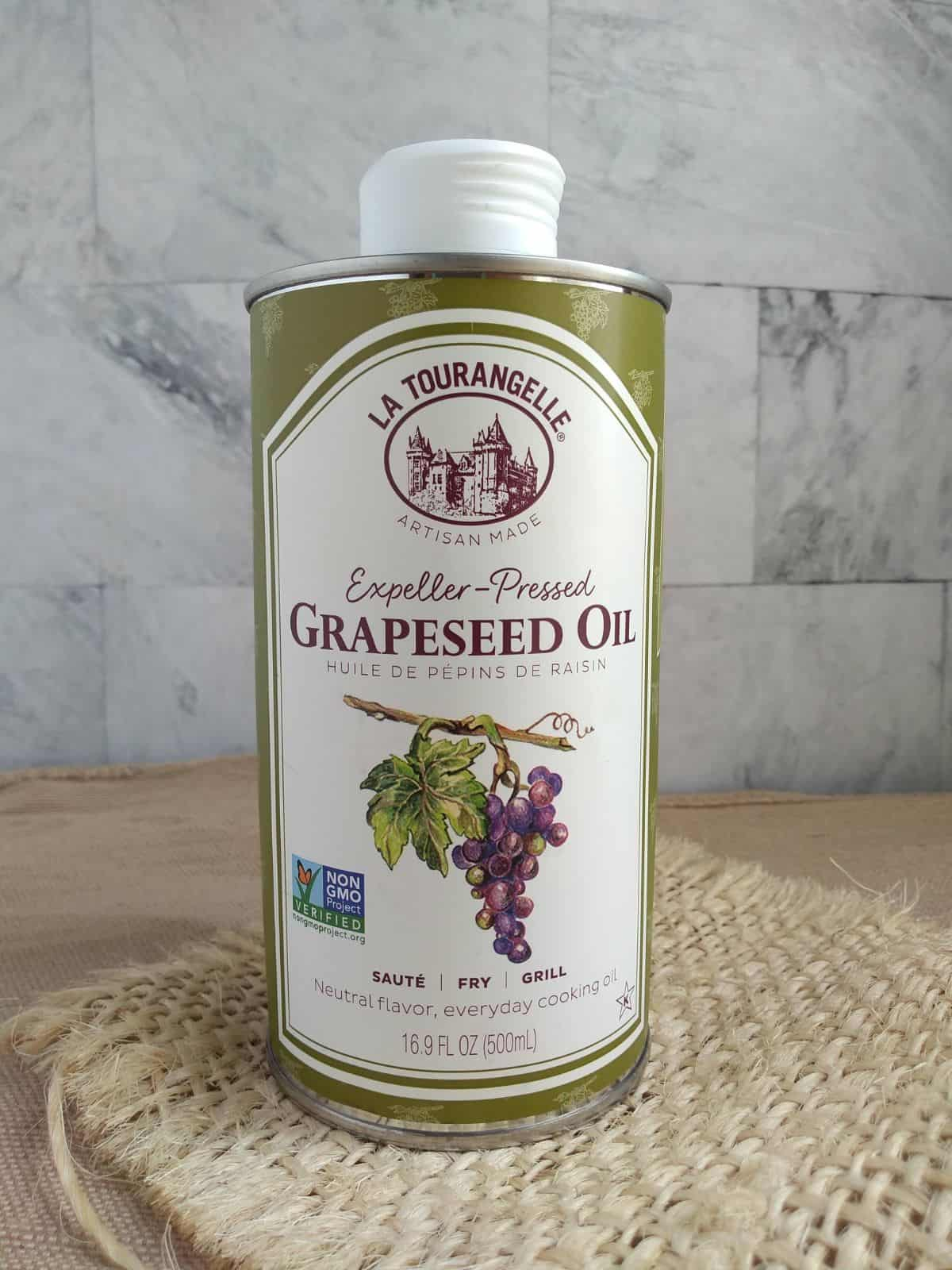 La Tourangelle Expeller-Pressed Grape seed Oil in a 16.9 oz container in front of a white title background.