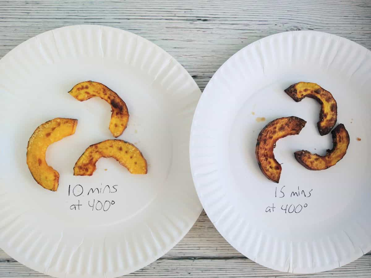 3 pieces each of air fryed Delicata squash on two paper plates. The plate on the left has been cooked for 10 minutes at 400 degrees. It has some brown spots on it. The squash on the right has been cooked for 15 minutes at 400 degrees. It has a lot more browning.